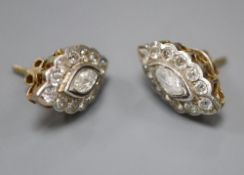 A pair of yellow metal and navette shaped diamond cluster earrings, 21mm gross 8.2 grams, with