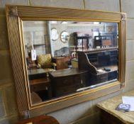 A rectangular gilt frame wall mirror, 110 x 79cm