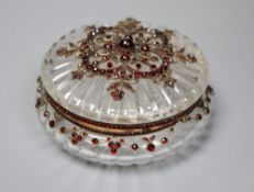 A Victorian yellow metal, cabochon and facet cut garnet mounted circular fluted glass powder jar,