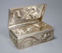 An early 20th century Chinese Export white metal cigarette box, embossed with a dragon, by Wang