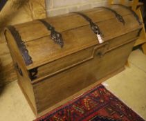 A 19th century pine dome top iron-bound travelling trunk/blanket chest on bun beet, width 128cm,