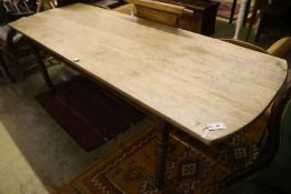 A 19th century Continental mahogany and fruitwood kitchen table, width 220cm, depth 80cm, height