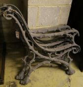 A pair of Victorian cast iron rustic bench ends and a matching central support