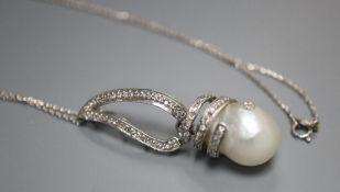 A modern 14k white metal, baroque pearl and diamond set drop pendant, on 750 white metal chain,