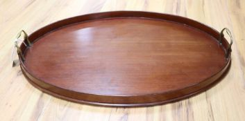 An oval wooden tray fitted brass handles, 62cm