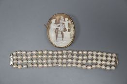 A modern quadruple strand cultured pearl bracelet, 15.8cm and a yellow metal mounted oval cameo