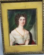 An early 19th century portrait miniature on ivory of a lady, half length, 8 x 6cm, later framed