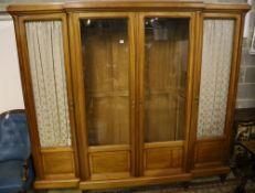 A Continental walnut breakfront bookcase, width 220cm, depth 46cm, height 203cm