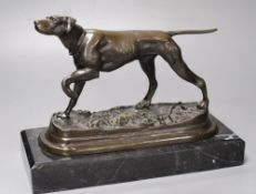 A bronze model of a pointer, unsigned, on marble plinth, length 31cm