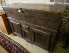 A French elm dough bin on cabinet base fitted two doors and a small central drawer, width 162cm,