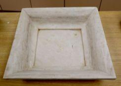 A square marble dish, 51cm sq.