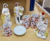 A pair of large Staffordshire figures, a similar Burns and his Mary group, 30cm, a graduated set