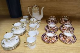 A set of six Royal Crown Derby miniature tea cups and saucers, date codes 1920's and a Noritake