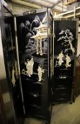 A Japanese black-lacquered and painted four-fold screen with applied decoration of geishas and