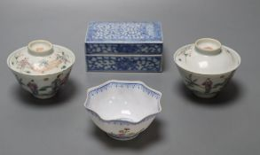 A pair of Chinese famille rose bowls and covers, late 19th century, a blue and white box and