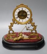 A 19th century French 'swinging cherub' mantel timepiece under glass dome, French movement with