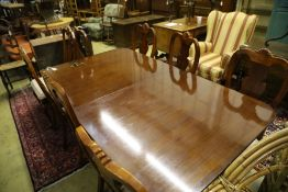 A reproduction mahogany twin pillar extending dining table and eight George I style chairs, 300cm