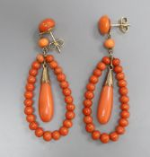 A pair of 9ct mounted coral bead earrings of open teardrop form, overall 51mm, gross 9 grams.