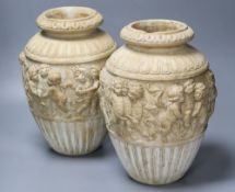 A pair of 19th century earthenware vases relief moulded in Italian Renaissance style, 30cm