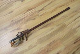 A 1912 Pattern Cavalry sword ER II, shagreen grip and 94cm etched, single edged blade, leather
