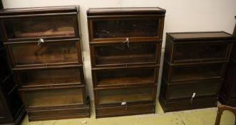 A set of two Globe Wernicke four section mahogany bookcases and a three section Globe Wernicke