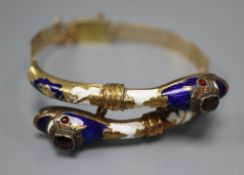 A Victorian pierced yellow metal, two colour enamel and garnet set twin serpent head hinged