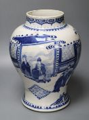 A Chinese Kangxi period blue and white baluster vase, repaired, 35cm