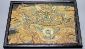 A Chinese Qing dynasty embroidered silk 'dragon' fragment, possibly Imperial, framed, 22 x 28cm