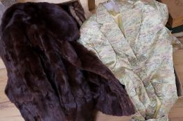 A Chinese embroidered silk celadon ground housecoat and a collection of vintage furs, including a