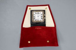 A Cartier stainless steel travelling alarm timepiece, with original fabric pouch
