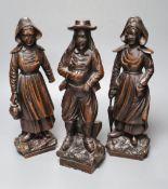 A set of three 19th century Dutch walnut figures of puritans, height 34cm