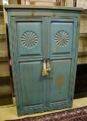 A 'distressed' carved and blue-painted pine double wardrobe, width 96cm