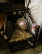 An oak Turners chair and a warming pan