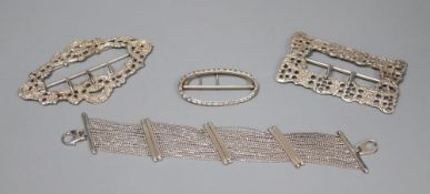 Three silver belt buckles and an Italian silver bracelet.