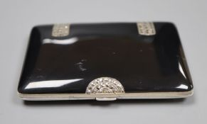 A late 1920's silver, black enamel and marcasite set cigarette case, import marks for George