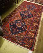 A Caucasian design red ground rug, 190 x 98cm