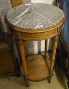 A Haentges Freres, Paris, circular marble top two tier table, diameter 47cm, height 84cm