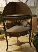 A George III mahogany bow front three tier washstand, width 58cm, depth 40cm, height 108cm