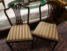 A set of four Hepplewhite style dining chairs (3 single, 1 arm) and four Edwardian dining chairs