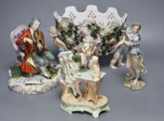 A Meissen style flower-encrusted reticulated oval porcelain jardiniere with cherub supports and