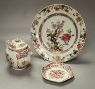 A 18th century Chinese famille rose export plate and an 18th century export teapot, cover and