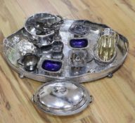 A large oval plated galleried tray and a collection of plated items, including an entree dish and