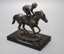 David Cornell, 1985. A cast bronze racehorse and jockey, entitled 'Champion Finish', on slate