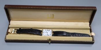 A gentleman's stylish modern silver gilt Dunhill quartz wrist watch, with rectangular Roman dial, on
