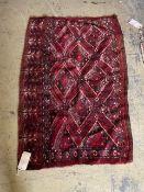 A Turkoman red ground camel bag, 130 x 90cm
