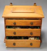 """A """"Community"""" silver plated canteen in three drawer pine chest, 36cm"""