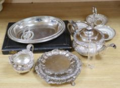 A cast and embossed silver plated teapot and matching milk jug, three plated card trays, etc.