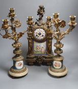 A 19th century French ormolu and Sèvres style porcelain matched garniture de cheminée