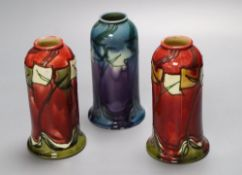 A pair of Minton Secessionist bell-shaped red ground vases (No 46) and a similar mauve-ground