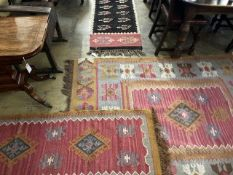 Three modern pink ground Kelim rugs, largest 200 x 155cm